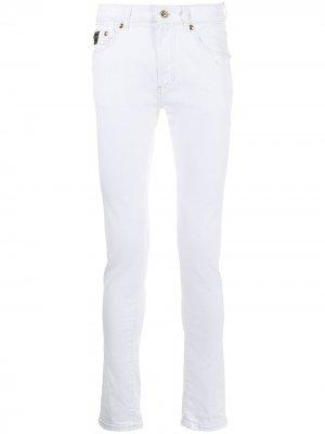 Джинсы скинни средней посадки Versace Jeans Couture. Цвет: белый