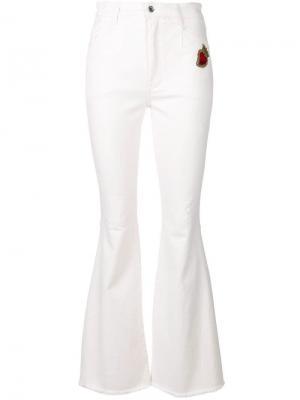 Расклешенные джинсы с заплаткой Sacred Heart Dolce & Gabbana. Цвет: белый