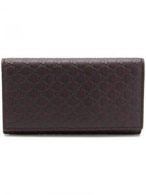 Signature foldover wallet Gucci. Цвет: коричневый