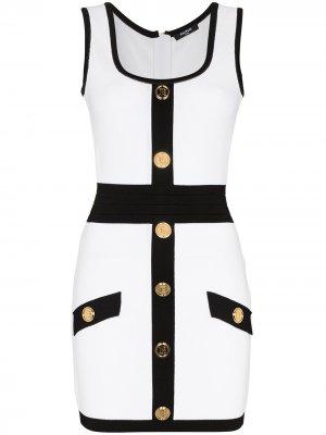 Платье мини без рукавов с декоративными пуговицами Balmain. Цвет: белый