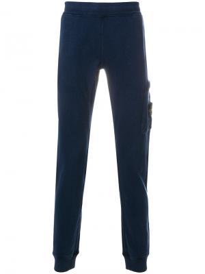 Спортивные брюки карго Stone Island. Цвет: синий