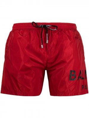 Плавки-шорты с логотипом Balmain. Цвет: красный