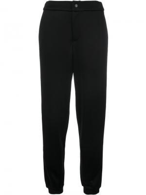 Спортивные брюки с лампасами металлик Jo No Fui. Цвет: черный