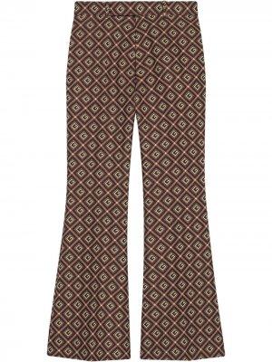 Расклешенные брюки с узором GG Damier Gucci. Цвет: красный