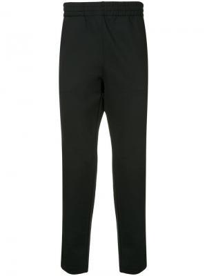 Спортивные брюки с лампасами Makavelic. Цвет: черный