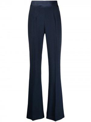 Расклешенные брюки со стрелками RAQUETTE. Цвет: синий