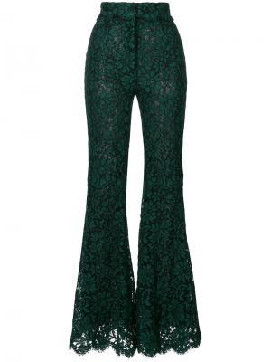 Расклешенные кружевные брюки Dolce & Gabbana. Цвет: зеленый
