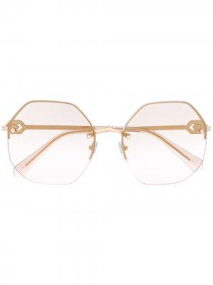 Солнцезащитные очки в геометричной оправе Bvlgari. Цвет: золотистый