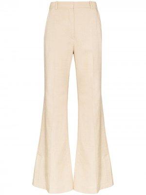 Расклешенные брюки Tena Joseph. Цвет: коричневый