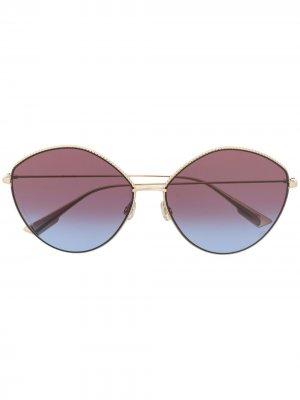 Очки с затемненными линзами в круглой оправе Dior Eyewear. Цвет: золотистый