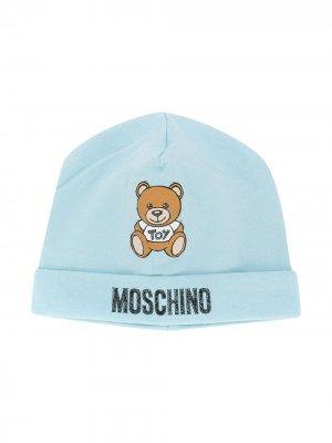 Шапка бини Teddy с логотипом Moschino Kids. Цвет: синий