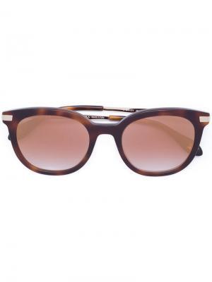 Солнцезащитные очки с зеркальными линзами Carolina Herrera. Цвет: коричневый