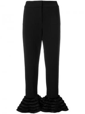 Расклешенные брюки с рюшами Alexis. Цвет: черный