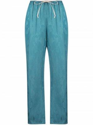 Укороченные расклешенные брюки Italia Merci. Цвет: синий
