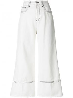 Укороченные расклешенные джинсы MSGM. Цвет: белый