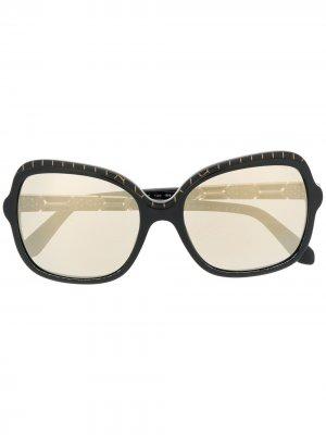 Солнцезащитные очки в массивной оправе Bvlgari. Цвет: черный