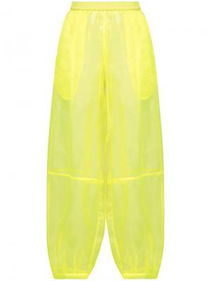 Прозрачные брюки-шаровары The Celect. Цвет: желтый