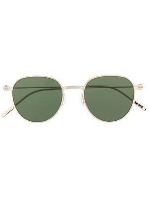 Солнцезащитные очки в круглой оправе Montblanc. Цвет: золотистый