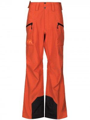 Лыжные брюки Helly Hansen. Цвет: оранжевый
