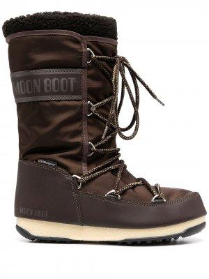 Массивные сапоги на шнуровке Moon Boot. Цвет: коричневый