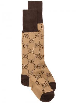 Носки с узором GG Gucci. Цвет: коричневый