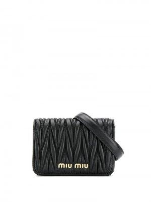 Поясная сумка с металлическим логотипом Miu. Цвет: черный