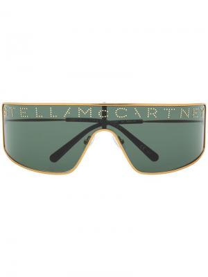 Солнцезащитные очки с заклепками Stella McCartney Eyewear. Цвет: золотистый