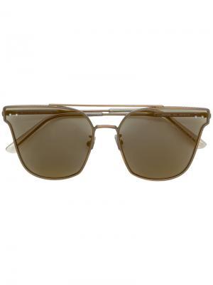 Солнцезащитные очки в оправе кошачий глаз с затемненными линзами Bottega Veneta Eyewear. Цвет: металлик