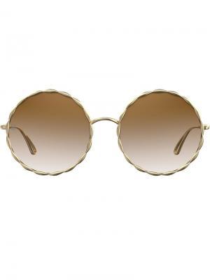 Солнцезащитные очки в круглой оправе с градиентными линзами Elie Saab. Цвет: коричневый