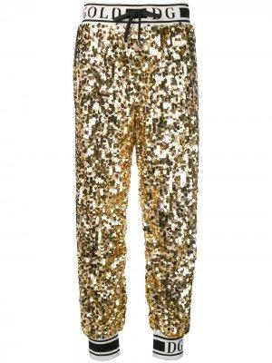 Брюки с пайетками и лампасами Dolce & Gabbana. Цвет: золотистый