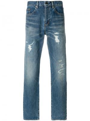 Джинсы кроя слим с рваными деталями Saint Laurent. Цвет: синий